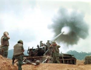 An Army 175mm M107 at Camp Carroll provides fire support for ground forces. (Credits: U.S. Army Heritage and Education Center)