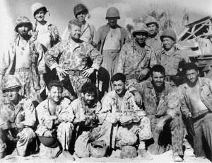 First Row: Tech. Sgt. Carlos Steele, Cpl. Jack Ely, Sgt Ferman H. Dixon, Staff Sgt. John F. Ercole, Cpl. E. Newcomb, and Sgt. Ernest J. Diet. Second Row: Pvt. Chris G. Demo, Sgt. Forrest Owens, Cpl. Jim R. Orton, and Cpl. Raymond Matjasic Back Row: Sgt. Roy Olund, Capt. Louis Hayward, Marine Gunner John F. Leopold, Staff Sgt. Norman Hatch. Pfc. William Kelliher was not present for the picture.