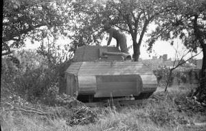 An officer inspects a German dummy tank made of wood, 31 July 1944. (Credits: © IWM (B 8296))