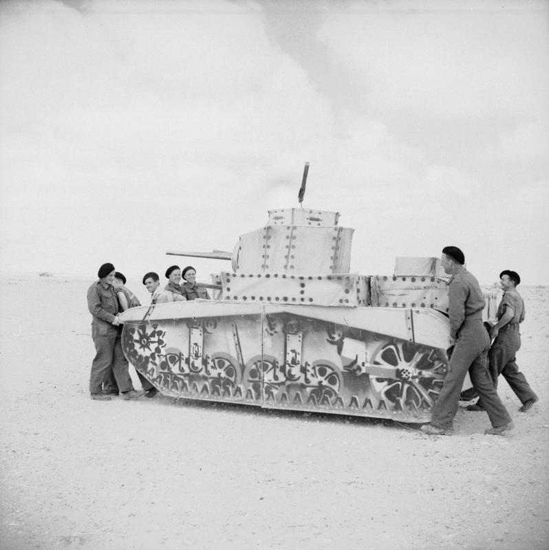 Troops carry a dummy Stuart tank, 3 April 1942. (Credits: © IWM (E 10147))
