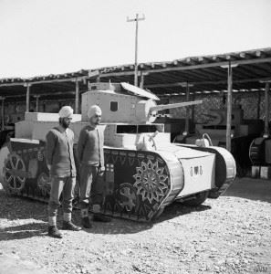 Two Sikh members of an Indian camouflage unit in Baghdad, with a dummy Stuart tank mounted on a car chassis, 25 March 1942. (Credits: © IWM (E 9697))