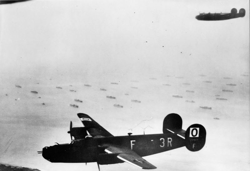 Consolidated B-24H Liberators flying over part of the Allied invasion fleet gathered off the Normandy coast.