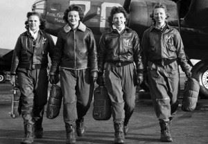 """Women Airforce Service Pilots pilots Frances Green, Margaret """"Peg"""" Kirchner, Ann Waldner and Blanche Osborn, leave their B-17 Flying Fortress aircraft, called Pistol Packin' Mama, during ferry training at Lockbourne Army Airfield, Ohio, 1944."""