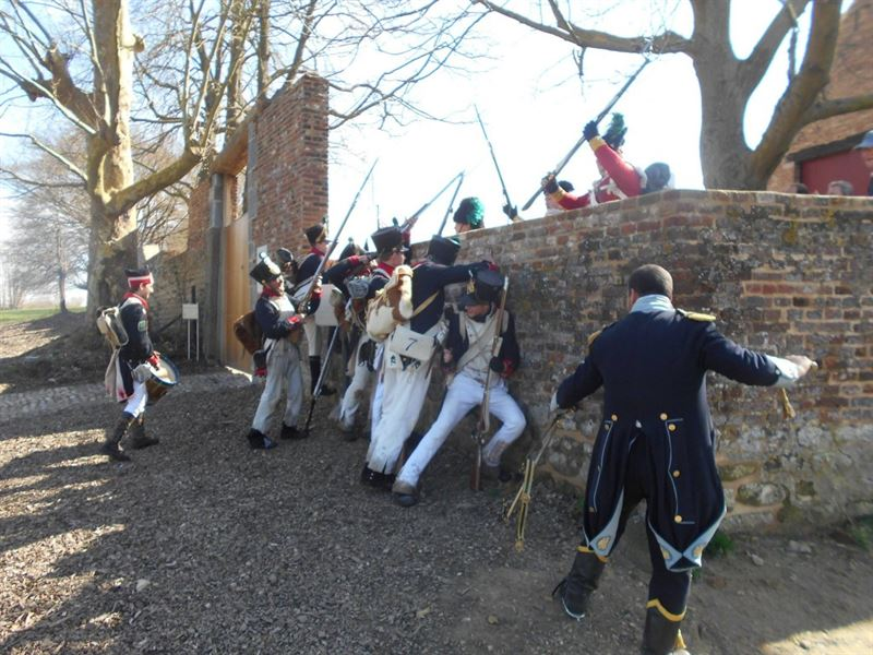 Defense of the North Gate, Hougoumont staged by re-enactors. Editorial note: The defense was done by the Cold Stream Guards and not the unit depicted within this photograph.
