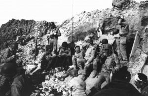 Rangers rest atop the cliffs at Pointe du Hoc, which they stormed in support of the Omaha Beach landings on D-Day, June 6, 1944. (Credits: NARA)