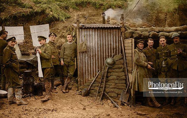Artillerymen outside dugouts.