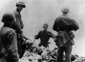 A Japanese naval lieutenant surrounded by American soldiers