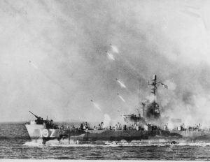 Rockets from an American warship stream toward Okinawa Island