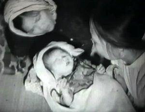 Child birth by torch light