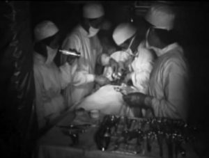 Surgery by torch light