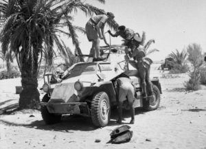 British soldiers inspecting a captured German SdKfz 222 armoured car, 24 June 1941, in North Africa.