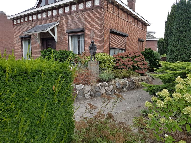 The memorial of Karl-Heinz Rosch, a small remembrance in his honor in a garden of a home.