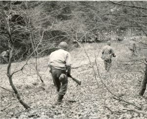 A patrol of Company F, 3rd Battalion, 18th Infantry Regiment, 1st Infantry Division, searches the woods between Eupen and Butgenbach, Belgium, for German parachutists who were dropped in that area.