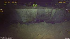 Another picture with possibe damage from a torpedo or impacting the seafloor. That is the hangar deck visible towards the top of the photo.