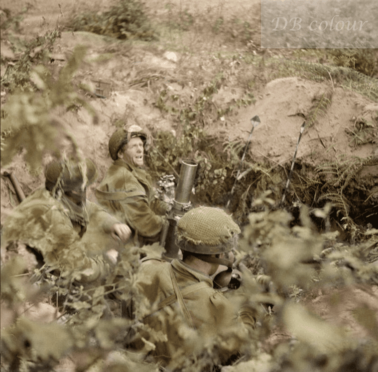 British Paratroops at Arnhem 'Operation Market Garden'. September 20, 1944. A 3-inch mortar team of Nº23 Mortar Platoon, Support Company, 1st (Airlanding) Battalion, Border Regiment, bombarding enemy positions from the edge of the woodland to the south of Van Lennepweg. The team are (left to right) Privates Norman 'Jock' Knight, Ron 'Ginger' Tierney and Cpl. Jim McDowell.