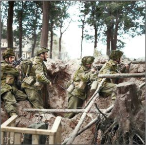 Men of No 3 Platoon, 'R' Company, 1st Parachute Battalion, 1st (British) Airborne Division armed with Bren gun and No. 4 rifles defend a large shell hole outside Arnhem, during Operation 'Market Garden', 17th September 1944.