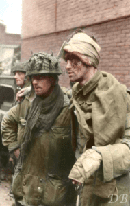 Sappers Charles Grier and wounded Dick Robb both from 'B' troop, 1 Para Squadron, Royal Engineers. This picture was taken at 1530hrs on Wednesday the 20th September 1944, in a builders yard near their last position held at the Van Limburg Stirum School in Arnhem.