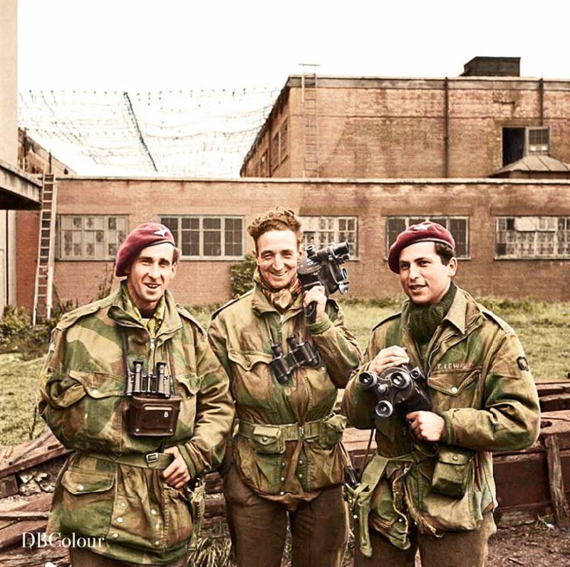 "The three Army Film and Photographic Unit Photographers who took the graphic still and cine pictures of the 1st Airborne Division at Arnhem. The picture, which shows them with their cameras, was taken at the AFPU Centre at Pinewood Studios, Iver Heath, Buckinghamshire on 28 September 1944, the day that they arrived back. Smith was wounded in the shoulder. Left to right: Sgt. Dennis M Smith, Sgt. Gordon ""Jock"" Walker and Sgt. C M ""Mike"" Lewis."