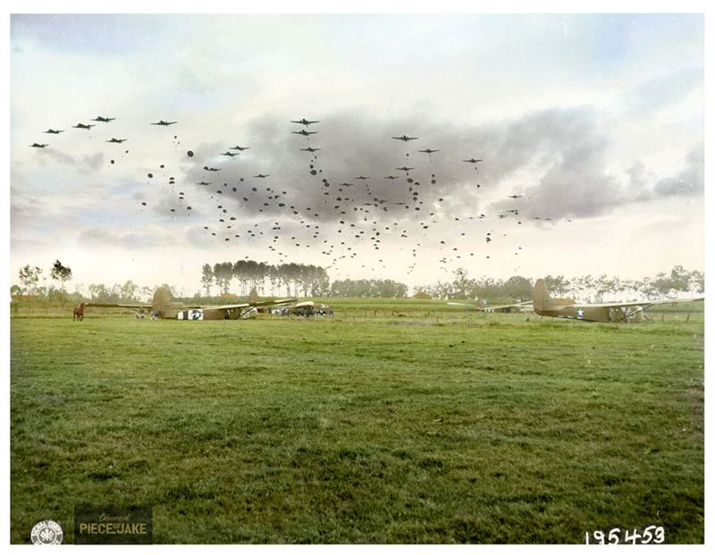 """A serial of Douglas C-47 Skytrains of the 315th Troop Carrier Group, dropping 41 sticks of the 1st Polish Airborne Brigade into DZ """"O"""" near Grave, southwest of Nijmegen in Holland, on September 23, 1944, D+6 of Operation Market Garden."""