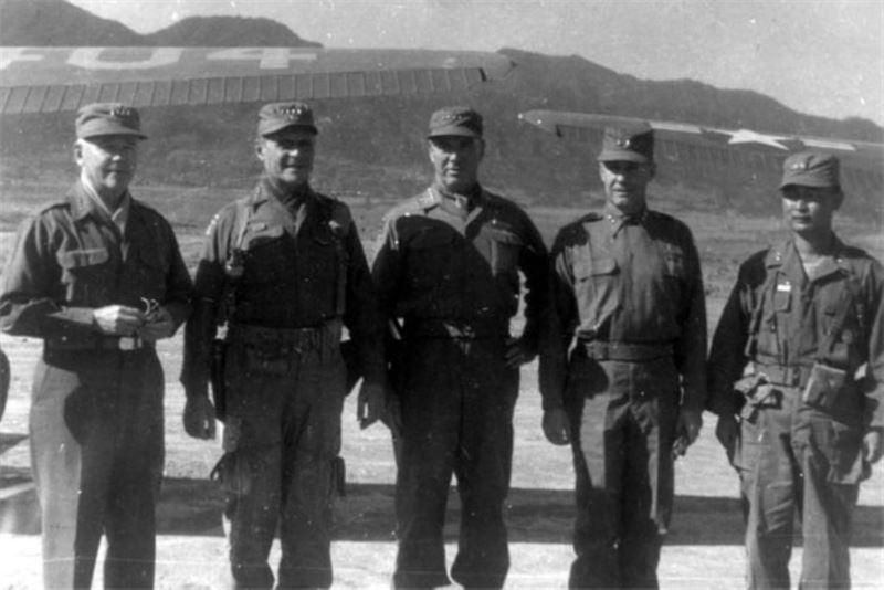 Inspection by leading figures of the UN Forces nearby Punchbowl, Korea. (Left to right: Gen. J. Lawton Collins, Gen. Matthew Ridgway, Gen. James Van Fleet, X Corps commander Maj. Gen. Clovis E. Byers, Maj. Gen. Paik Sun-yup)
