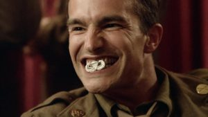 "Frank John Hughes as Staff Sergeant William ""Wild Bill"" Guarnere"