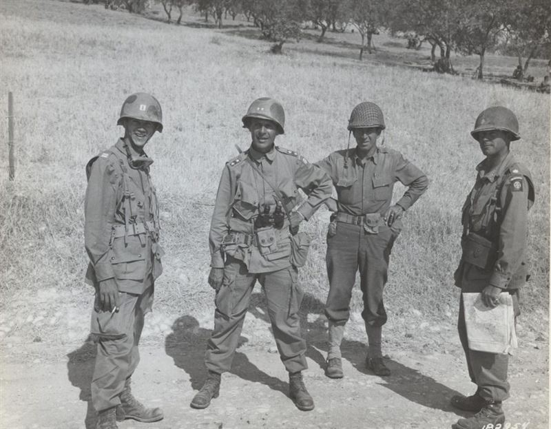Major General Matthew B. Ridgway (center), Commanding General, 82nd Airborne Division, and staff, overlooking the battlefield near Ribera, Sicily, 25 July 1943. Each officer wears the distinctive jump jacket and pants with large pockets and boots. (Matthew B. Ridgway Collection).