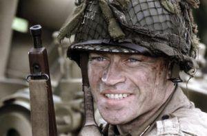 "Neal McDonough as First Lieutenant Lynn ""Buck"" Compton"