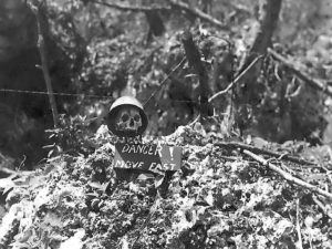Skull and danger sign in combat area. October 1944.