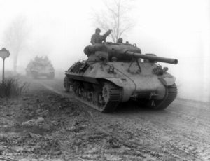 U.S tank destroyers move through the fog